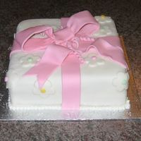 Present Cake Chocolate cake with raspberry filling & covered in fondant.