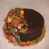Thanksgiving, Fall Leaves Thanksgiving cake 2008. Chocolate cake with ganache filling. Chocolate fondant and gumpaste leaves & pumpkins.