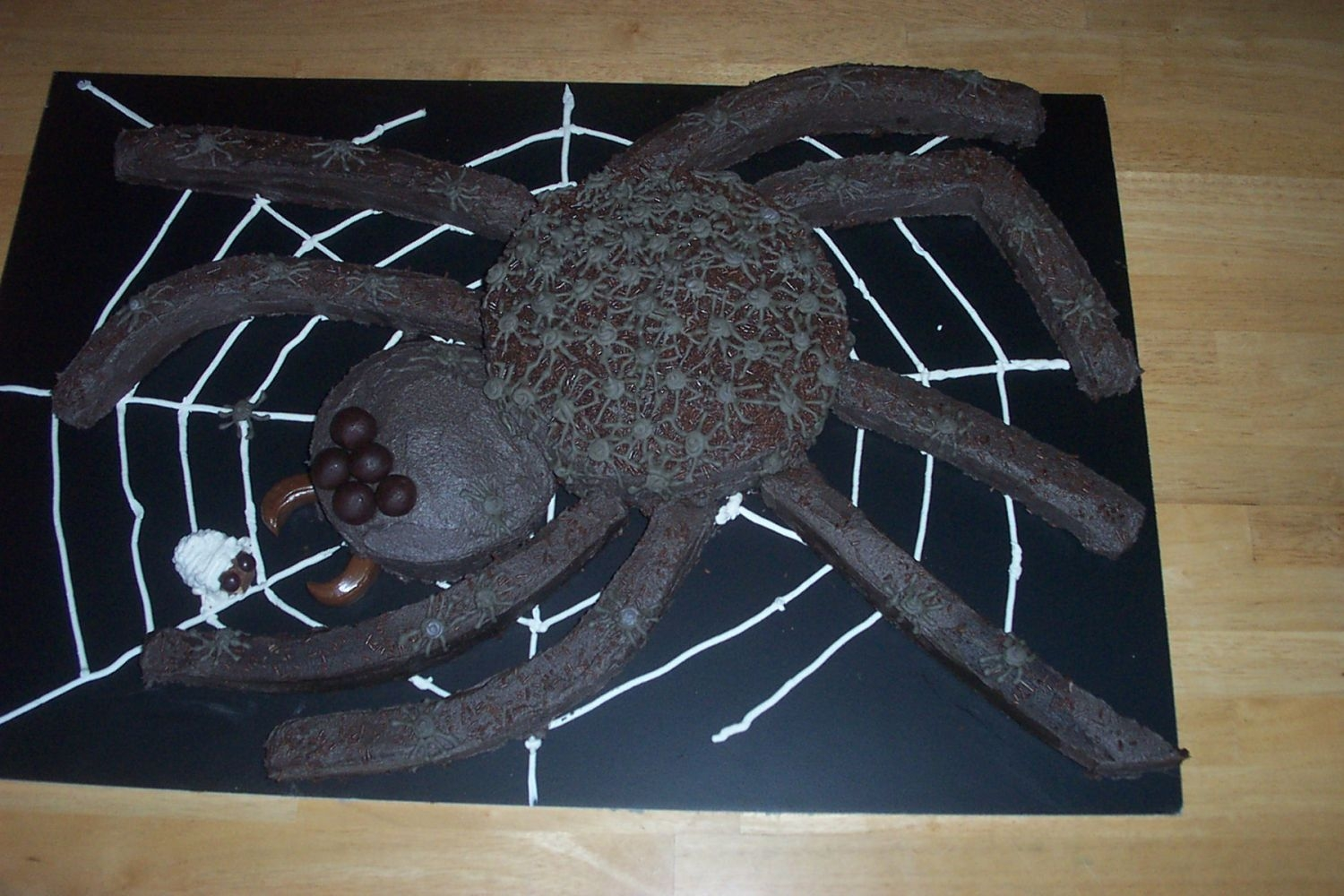Spider Cake  This was great fun to make. The legs were sliced from a 13x9 sheet, the body and head were rounds,the eyeballs and fangs were homemade...