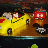 Mickey Mouse Car Cake This was done for my 4 year old's birthday. He loves Mickey Mouse Clubhouse. Mickey's car is actually red, but my red fondant...