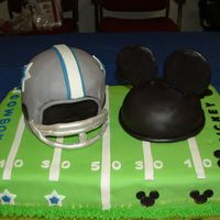 Dallas Cowboys And Mickey Mouse  This was a going away cake for someone in our office. Her two favorite things are the Dallas Cowboys and Mickey Mouse, so this is what I...