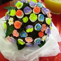 Mini Cupcake Boquet This is the cake I did for Amy's bridal shower. I wanted it to resemble her bouquet. I did 67 mini cupcakes each with a royal icing...