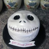 "Jack Skellington Cake This cake was for my nephews girlfriend. Its an 8"" cake carved. The filling is white chocolate mousse, and iced in vanilla buttercream..."
