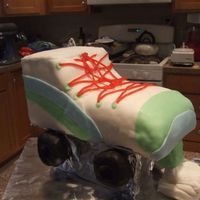 Rollerskate Cake This is a cake I did for a friend at work. I carved an 11x15 then frosted and covered in MMF. I used Rice Krispy Treats for the wheels and...