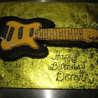 Guitar Cake This was my attempt at a guitar cake, it came out ok for my first. The client was happy so thats what matters.