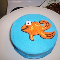 Collin's Smash Cake Buttercream icing and decorations Dorothy(Elmo's pet fish) was freehanded