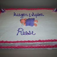 Sugar And Spice Fudge marble cake with buttercream icing, fonant baby and wiltons baby shower favors