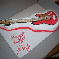 Fender Guitar Chocolate cake covered in buttercream. I used the Wilton's guitar cake pan and extended the neck using a small square cake carved.