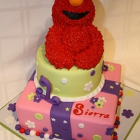 Elmo Cake I had a super great time making this cake. First time making a sculpted figure of rice crispy!