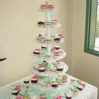 Shower Of Daisies Cupcake tower for a bridal shower. I used a variation of teal for my rolled fondant daisy cut outs.