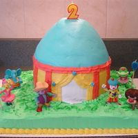 Jojocake.jpg A friend and I made this Jojo's Circus cake for my daughter's 2nd birthday. The base is a simple sheet cake, the tent is two 8&...