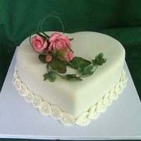 Heart Shapped Cake Covered with sugarpaste .Flowers are also made of sugarpaste/TFL
