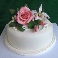 Elegant Cake All the flowers and leaves are sugarpaste flowers.I used dusting colours.Thanks for looking.