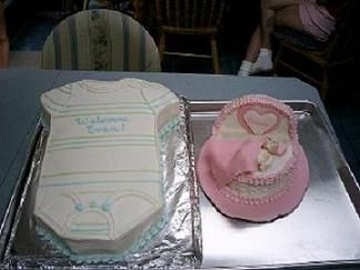 Baby Shower Cakes onsie is buttercream icing. Bassinet is buttercream with fondant accents.