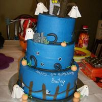Bailey's Boo-Day! Bottom layer is a dummy. Inspired by a few different cakes from here on CC. Frosted in Buttercream with fondant decorations and a sugar...