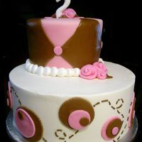 "Maddy Cake buttercream (white) and MMF (brown/pink)6"" + 10"" rounds"