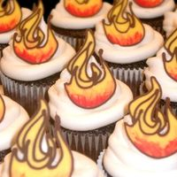 Fire + Icing needed a non-girly theme for the guys at harley davidson (the gals liked them too!)cupcakes with buttercream swirl and candy melt flame