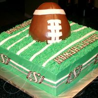 "Saskatchewan Roughriders our local CFL football team just won the Grey Cup last night!10"" square cake with rice krispie football. All buttercream with hand..."