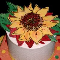 Sunflower Close Up detail of top of sonechko cakebuttercream (white) with candy melt sunflower