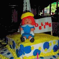 Madeline, France BC with fondant accent. Madeline and sign made of fondant. Eiffel tower made of royal icing.