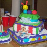 Baby Einstein Cake 3-tiered BC covered cake with fondant accents, caterpillar and plaques.