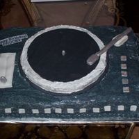 For A Dj Turntable cake. Buttercream icing with fondant accents.