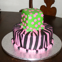 Hot Pink Zebra Stripes For a friends daughter who told me this was exactly what she had pictured.10in round w/ 4in square, butter cream w/ fondant accents