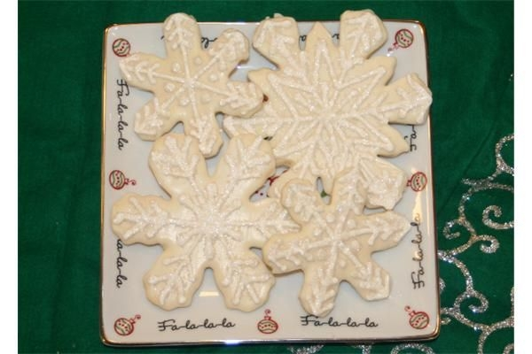 Snowflake Cookies Dipped in white choc, piped in royal icing, dipped in glitter. 3, 4 and 5 inch. Thanks to all the cookies on this site for ideas!