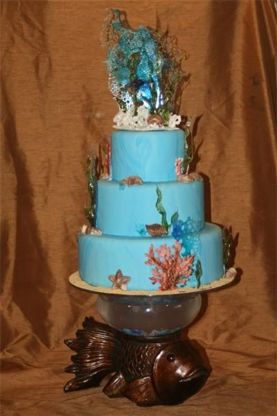 Underwater On Fish pulled suger, royal icing, chocolate shells, marbled fondant. 6, 9,12 inch . Made to use the fish bowl for a stand. This was re-set up at...