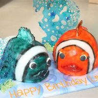 Fish fish made from 2-7inch oval pans each. Buttercream. Airbrushed. Isomalt bubbles
