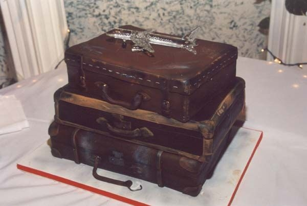 Luggage Wedding Cake My favorite cake I've done to date! 2 12x18's one 11x15 fondant covered to look like distressed luggage