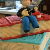 Graduation Guitar Player My first gum paste free-form 3D picture on top of 2 cake books covered in buttercream.