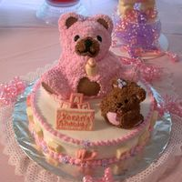 Mommy And Baby Bear 14 inch round cake topped with 2 bear shaped cakes and decorated with edible homemade chocolate molds.