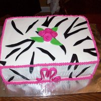 Simple Zebra Simple zebra and pink cake. Double 9x13 strawberry swirl cake. Buttercream icing with fondant accents.