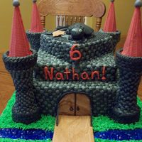 Castle castle cake with Toothless the dragon on top. Buttercreme with fondant accents. TFL!