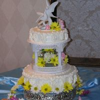June Jubilee   This cake is adapted from a Wilton design. It is carrot with spice buttercream and sweet peas down the sides. I also used fresh flowers.