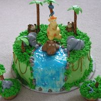 Jungle Friends  This is my adaptation of another cake addicts cake. The cake is a chocolate layer cake decorated with buttercream. The animals are hand...