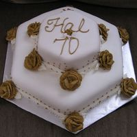 70Th Birthday   This is my first Fondant cake and I had to do this for a man. I used the MMF. I love this stuff!!