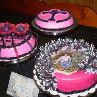 Picture_002.jpg  My Granddaughter wanted a Goth (now called Emo) cake for her birthday. The Fairy is an edible image. Lillies are royal icing. Celtic cross...