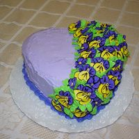 Dsc00035.jpg This cake was done for my daughter's 25th birthday. I had a lot of fun doing the pansies.