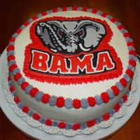 "Bama Cake   10"" 4 layer white cake done with buttercream icing. The Bama Logo was done in colorflow. I raffled this and the Auburn cake off."