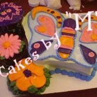 Butterlfly   this was an ice cream cake with a few 6' chocolate cakes on the side. all bc deco