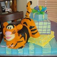 Pouncing Tigger  White cake/ Vanilla smbc...rice crispy sculpture. everything edible. I designed this one...nobody in the world has had one like it! that...