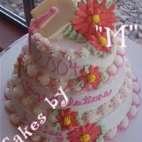 Graduation Cake  this was for my best friend! those are always the best cakes to make! 10 - 8 -6 champagne cakes with bc frosting...royal icing gerbers and...