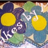 Daisies This (2 side by side- 15'' hexagon (w/ 2 - 6' hexes for leaves) cake is going to be turned into a character cake for a...