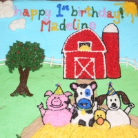 Farm Animal Birthday Cake made for a one year old's birthday, with side view and a separate haystack smash cake. Picture taken from a napkin of a farm...