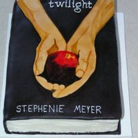 Twilight Cake Cake was for my oldest daughter's 13th birthday party. Frosted in BC, then covered in chocolate MMF, colored black. RI piping for...