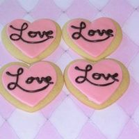 "Heart Cookies Butter cookies with MMF. ""Love"" is piped with melted chocolate."