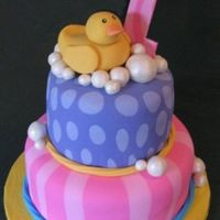 Just Ducky Made to match the first birthday rubber ducky party tableware from Oriental Trading Company. All decorations are fondant. Bubbles painted...