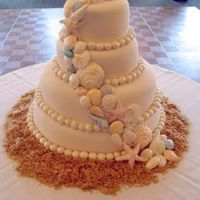 Seashell Wedding Cake My first wedding cake! White butter cake with fresh lime curd and raspberry fillings. Covered in fondant with chocolate shells. Layers are...